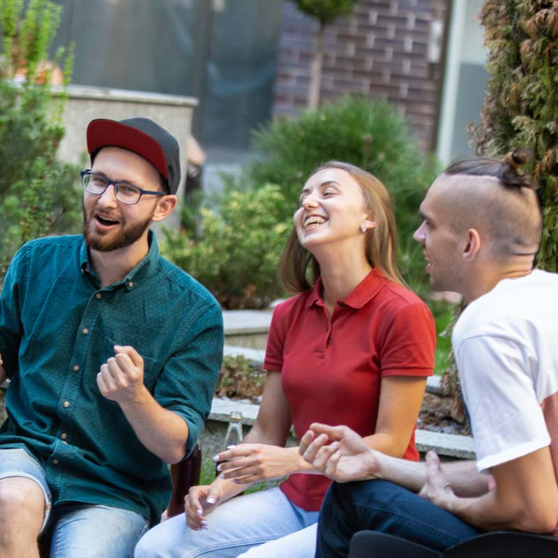 three young people laughing